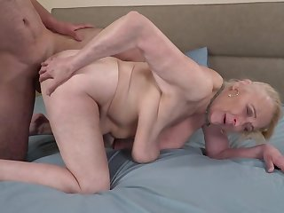 A fat hairy dude is fucking a horny old granny not susceptible the bed